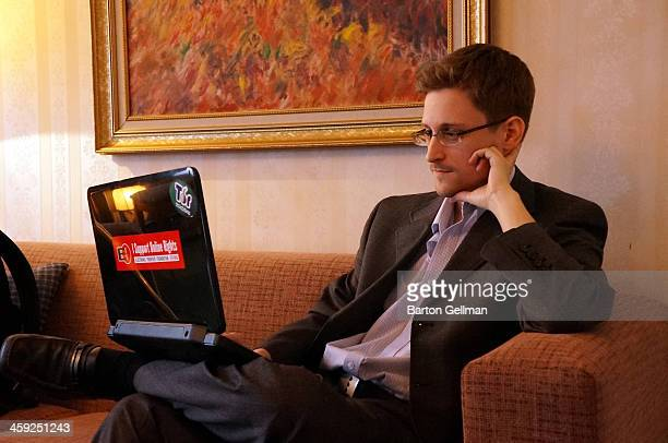 EXCLUSIVE ACCESS PREMIUM RATES APPLY Former intelligence contractor Edward Snowden poses for a photo during an interview in an undisclosed location...