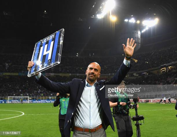 Former Inter Milan and Lazio Argentine midfielder Juan Sebastian Veron holding a jersey he received during a career achievement ceremony acknowledges...