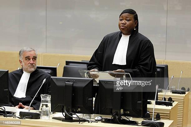 Former International Criminal Court's chief prosecutor Luis MorenoOcampo listens as Fatou Bensouda is holding her first speech as new prosecutor...