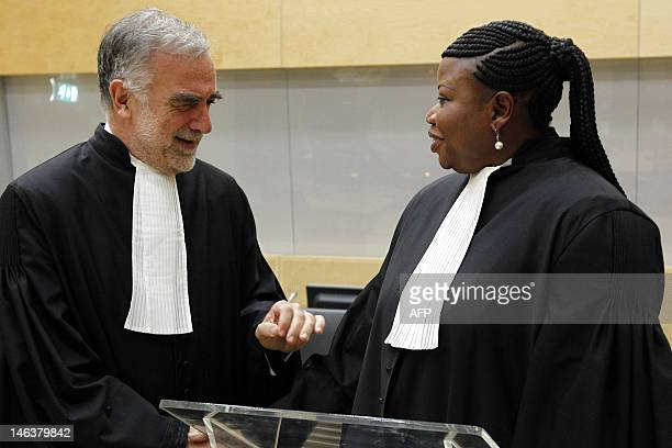 Former International Criminal Court's chief prosecutor Luis MorenoOcampo speaks with ICC's new chief Fatou Bensouda after her swearingin ceremony as...