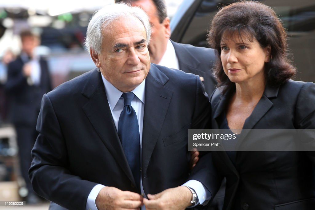 Former International Monetary Fund (IMF) chief Dominique Strauss-Kahn (L) enters Manhattan Supreme Court with his wife Anne Sinclair on where he is expected to plead not guilty to charges that he sexually assaulted a hotel housekeeper last monthJune 6, 2011 in New York City. Strauss-Kahn, who was expected to be a contender for the French presidency, is making his first court appearance since he was let out on $1 million bail and set under house arrest last month.