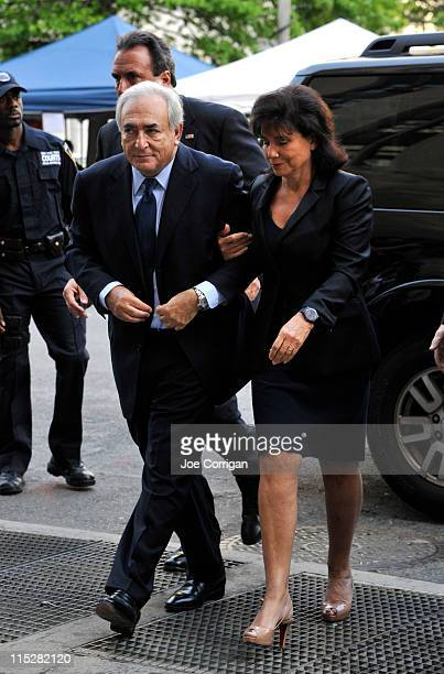 Former International Monetary Fund chief Dominique StraussKahn joined by his wife Anne Sinclair enters Manhattan Supreme Court on June 6 2011 in New...