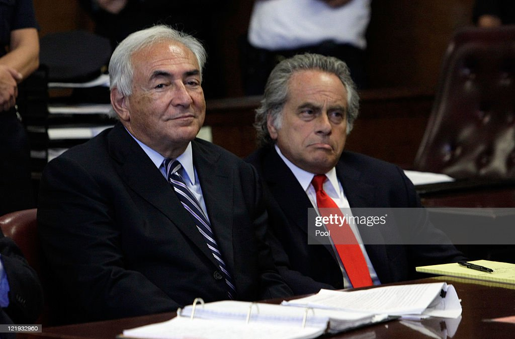 Former International Monetary Fund (IMF) director Dominique Strauss-Kahn (L) appears before a judge with his lawyer, Benjamin Brafman (R) in Manhattan district court on August 23, 2011 in New York City. A judge officially granted the Manhattan District Attorney's office motion to dismiss charges against Strauss-Kahn who was accused by Nafissatou Diallo, a hotel maid of sexual assault charges.
