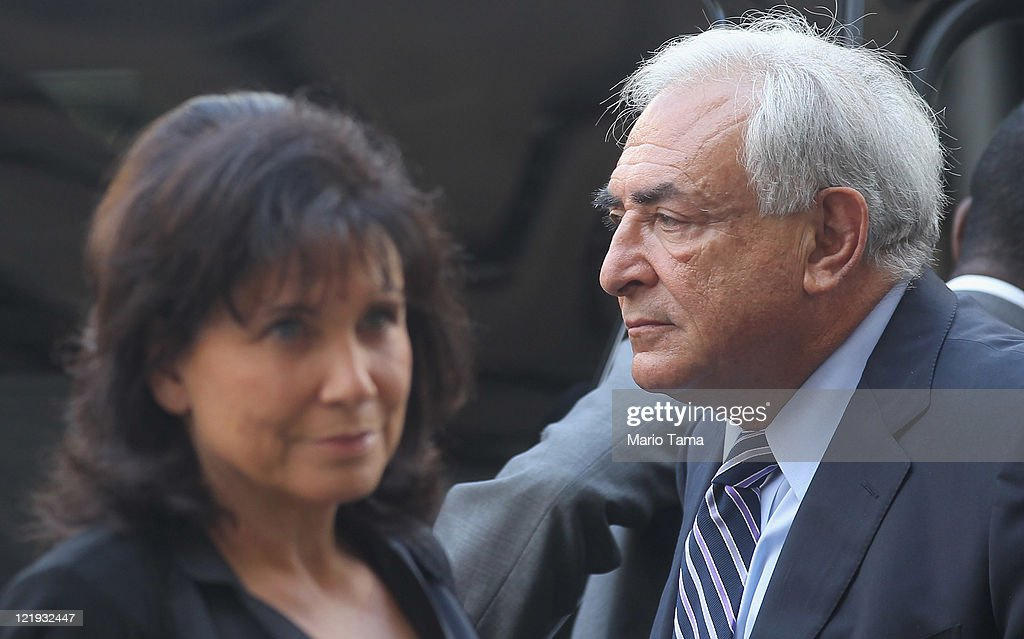 Former International Monetary Fund (IMF) director Dominique Strauss-Kahn (R) enters Manhattan State Supreme Court with his wife Anne Sinclair on August 23, 2011 in New York City. The Manhattan District Attorney's office has filed a motion to dismiss the sexual assault charges against Strauss-Kahn.