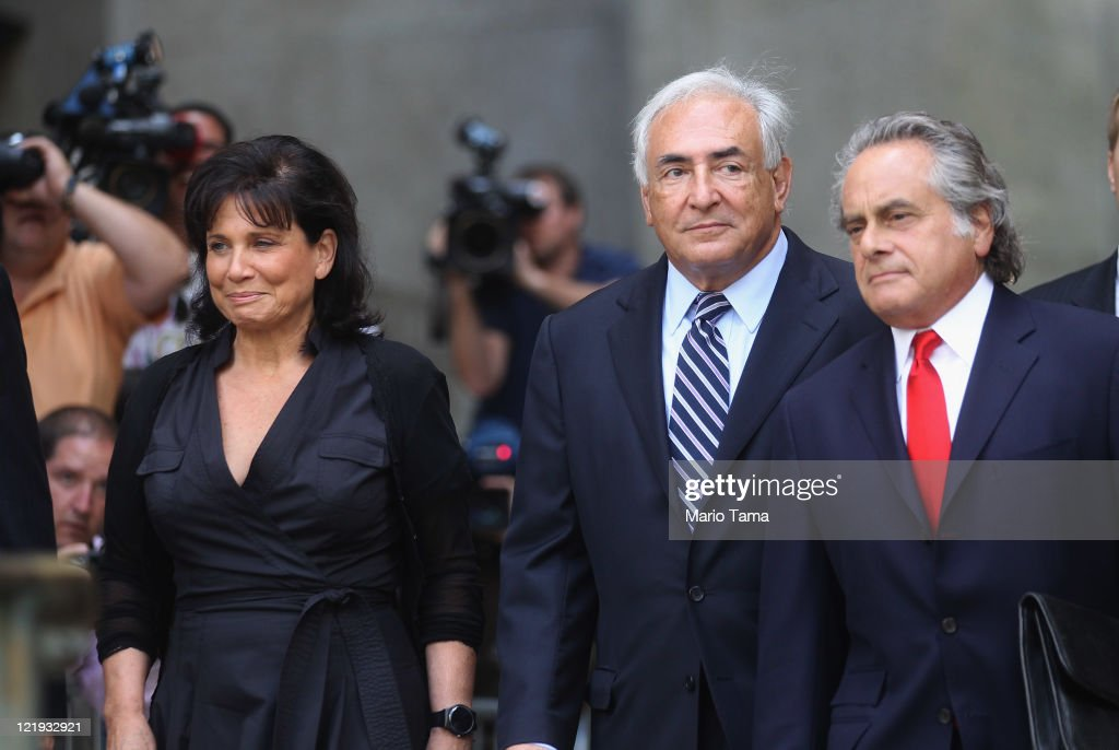 Former International Monetary Fund (IMF) director Dominique Strauss-Kahn (C) departs Manhattan State Supreme Court with his wife Anne Sinclair (L) and attorney Benjamin Brafman on August 23, 2011 in New York City. The Manhattan District Attorney's office has filed a motion to dismiss the sexual assault charges against Strauss-Kahn.
