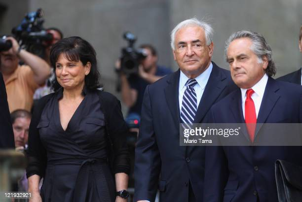 Former International Monetary Fund director Dominique StraussKahn departs Manhattan State Supreme Court with his wife Anne Sinclair and attorney...