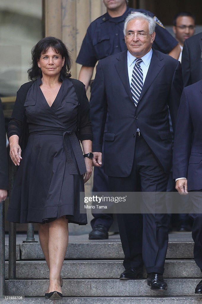 Former International Monetary Fund (IMF) director Dominique Strauss-Kahn (R) departs Manhattan State Supreme Court with his wife Anne Sinclair on August 23, 2011 in New York City. A judge dismissed the criminal sexual assault charges against Strauss-Kahn today.