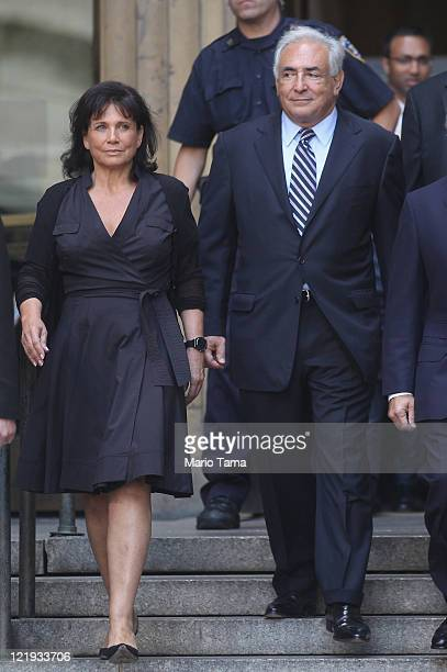 Former International Monetary Fund director Dominique StraussKahn departs Manhattan State Supreme Court with his wife Anne Sinclair on August 23 2011...