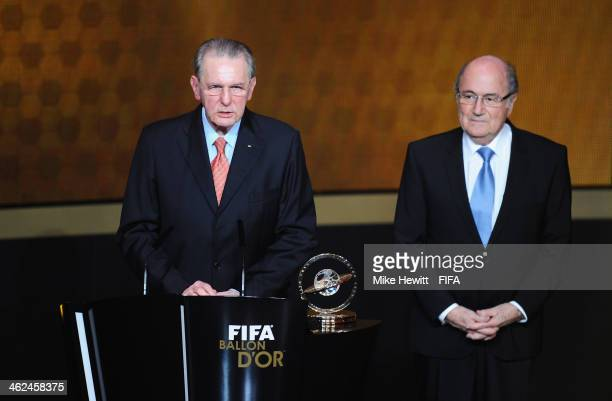 Former International Olympic Committee president Jacques Rogge collects his FIFA Presidential Award from FIFA President Joseph S Blatter during the...