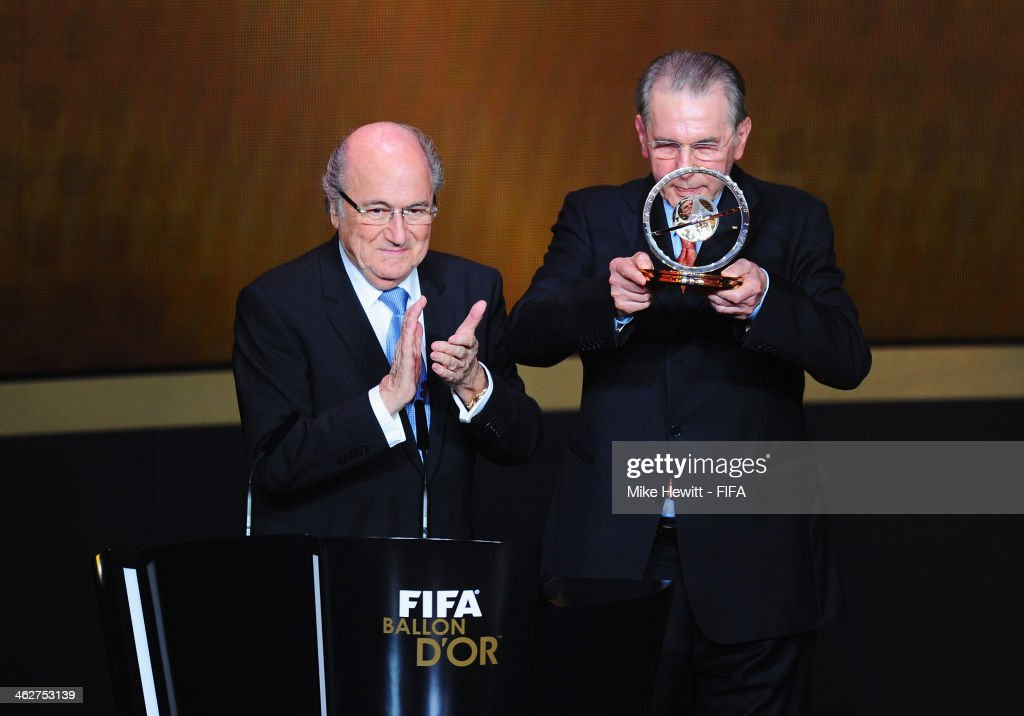 Former International Olympic Committee (IOC) president Jacques Rogge (R) collects his FIFA Presidential Award from FIFA President Joseph S. Blatter during the FIFA Ballon d'Or Gala 2013 at the Kongresshaus on January 13, 2014 in Zurich, Switzerland.