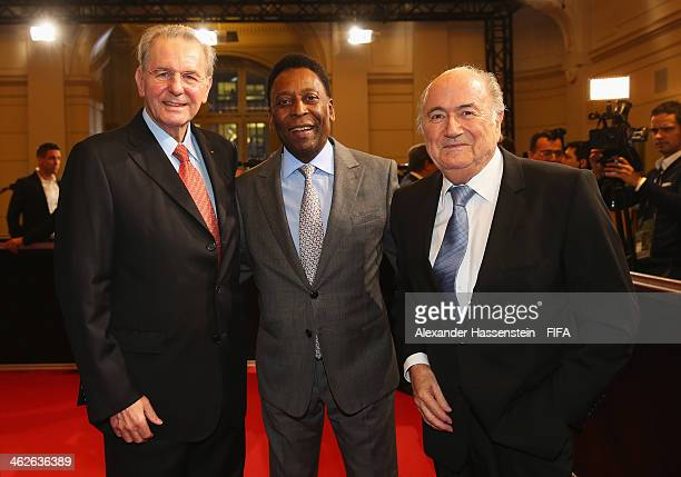 Former International Olympic Committee president Jacques Rogge poses with FIFA President Joseph S Blatter and Pele of Brazil as they arrive during...