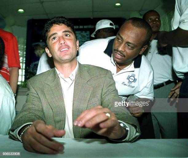 Former International soccer star Bresil Bebeto talks 19 May 2002 during a press conference in PortauPrince Haiti where he announced will be playing...