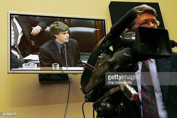 Former Internet child pornography victim Justin Berry appears on a video monitor as he testifies before the US House Committee on Energy and Commerce...