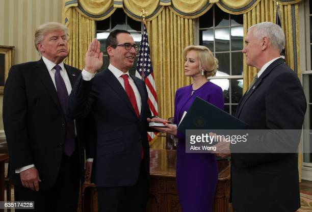 Former investment banker for Goldman Sachs Steven Mnuchin participates in a swearingin ceremony conducted by Vice President Mike Pence as fiancée...