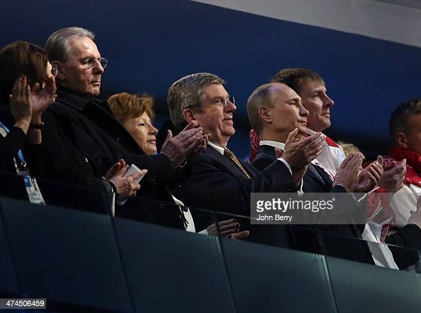 Former IOC President Jacques Rogge IOC President Thomas Bach President of Russia Vladimir Putin and double gold medalist bobsleigh pilot Alexander...