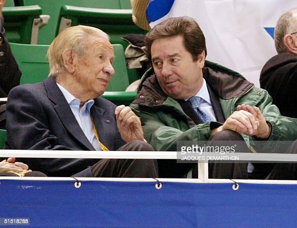 former IOC president Juan Antonio Samaranch chats with International Skating Union president Ottavio Cinquanta as they watch the first compulsory...