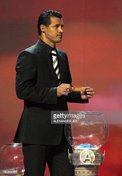 Former Iranian player Ali Daei draws Japan during FIFA 2010 football World Cup draw 25 November 2007 in Durban Japan arguably the football power on...