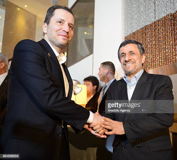 Former Iranian President Mahmoud Ahmadinejad is welcomed by Prof Dr Necmettin Erbakan Foundation chairman Fatih Erbakan as he arrives in Bursa for a...