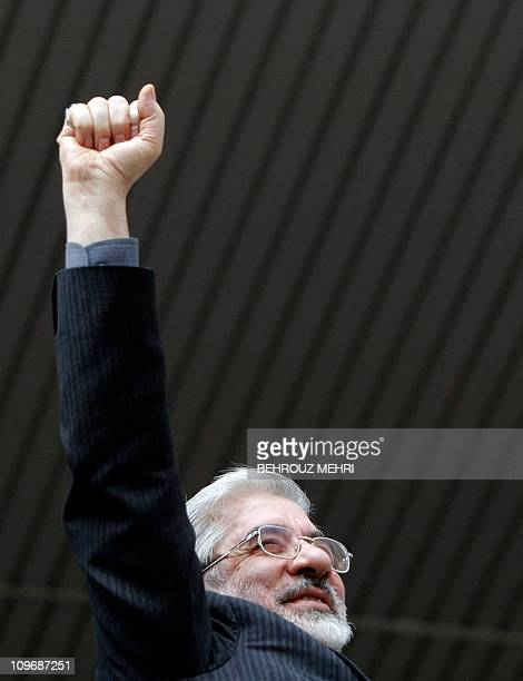 Former Iranian prime minister and presidential candidate Mir Hossein Mousavi gestures during a campaign rally at Enghelab stadium in the city of...