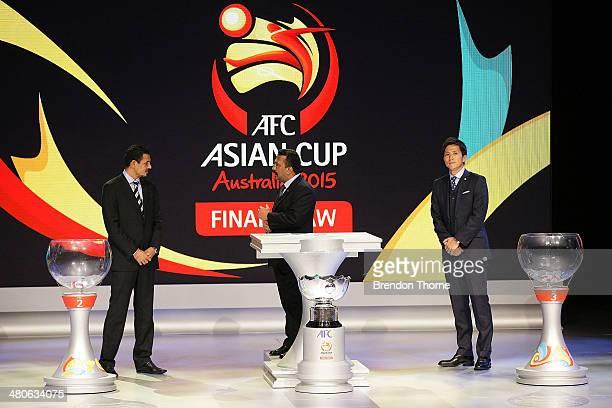 Former Iraqi footballer Younis Mahmoud AFC General Secretary Dato' Alex Soosay and former Japanese footballer Takashi Fukunishi stand on stage prior...