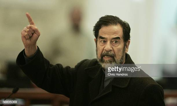 Former Iraqi leader Saddam Hussein shouts from his courtroom seat February 13 2006 in Baghdad Iraq The resumption of his trial began with a chaotic...