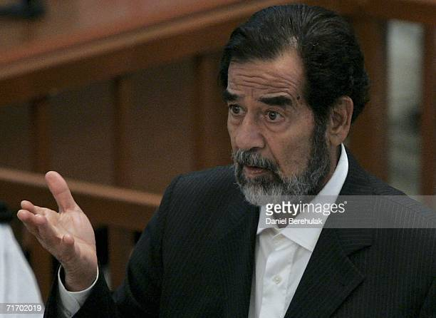 Former Iraqi President Saddam Hussein addresses the court during day three of the Anfal campaign trial in Baghdad's heavily fortified Green Zone on...