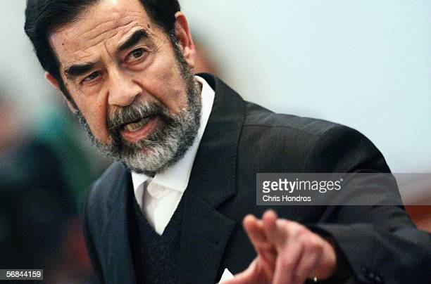 Former Iraqi President Saddam Hussein addresses the court of the Iraqi High Tribunal inside the heavily fortified Green Zone on February 14 2006 in...