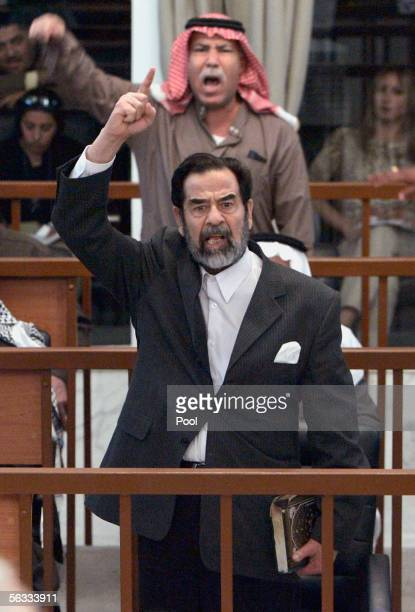 Former Iraqi President Saddam Hussein and Barzan Ibrahim alTikriti berates the court during their trial held under tight security in the heavily...
