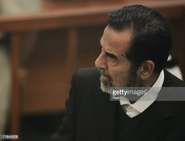 Former Iraqi President Saddam Hussein argues with the new chief judge Mohammed alUreybi as he was asked to leave the court in the fortified Green...