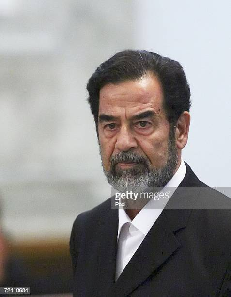 Former Iraqi President Saddam Hussein as he receives his guilty verdict during his trial in the fortified 'green zone' on November 5 2006 in Baghdad...