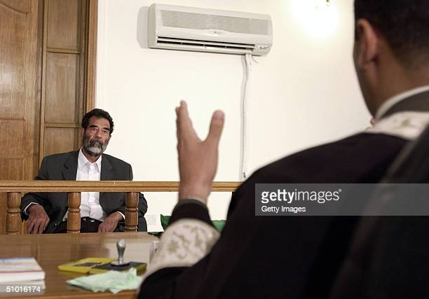 Former Iraqi President Saddam Hussein interacts with the judge in an Iraqi courtroom July 1 2004 in Baghdad Iraq Hussein was read a list of charges...