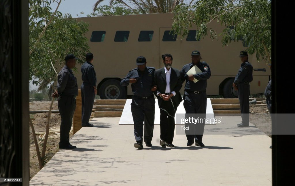 Saddam Hussein Hears Charges Read In Iraqi Court : News Photo