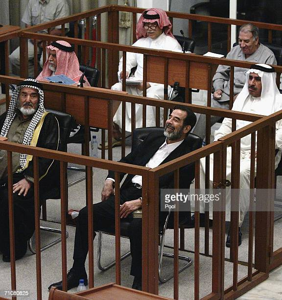 Former Iraqi President Saddam Hussein laughs while listening to the testimony of a defence witness with his coaccused Abdullah Kadhem Ruaid Awad...