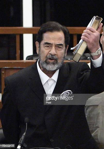 Former Iraqi President Saddam Hussein shouts as he receives his guilty verdict during his trial in the fortified 'green zone' on November 5 2006 in...
