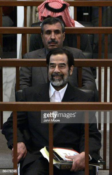 Former Iraqi President Saddam Hussein smiles during court proceedings against him and his codefendants in the resumption of their trial December 21...
