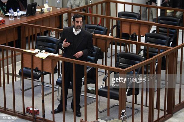 Former Iraqi President Saddam Hussien argues with prosecutors while testifying during crossexamination in his trial held April 5 2006 in Baghdad's...