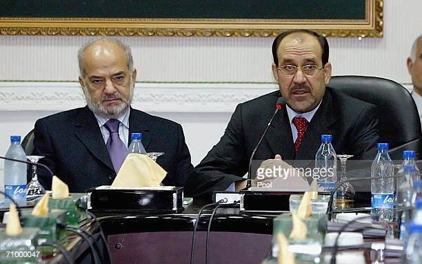 Former Iraqi Prime Minister Ibrahim alJaafari attends with New Iraqi Prime Minister Nuri alMaliki the first cabinet meeting i May 21 2006 in Baghdad...