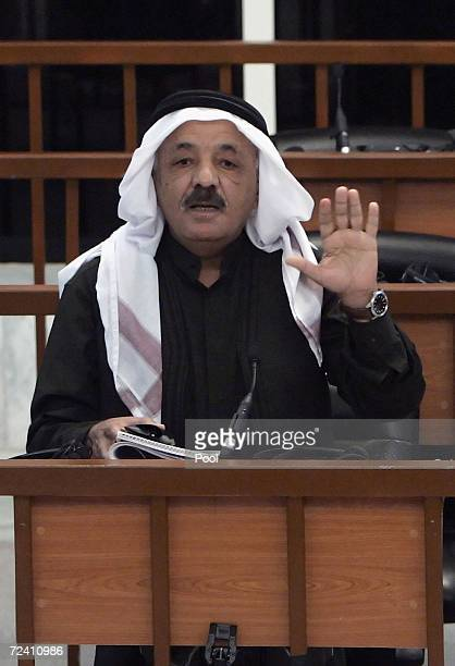 Former Iraqi Vice President Taha Yassin Ramadan argues with chief judge Raouf Abdel Rahman as he receives his verdict during his trial in the...