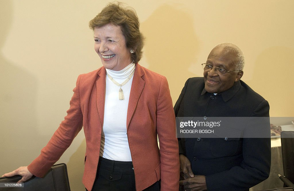 Former Irish President Mary Robinson (L) and South African Archbishop Desmond Tutu, part of a delegation of the group of influential statesmen known as The Elders, arrive on May 27, 2010 to meet South African President Jacob Zuma at his office in parliament in Cape Town. The Elders group was created by South Africa's former President Nelson Mandela to offer the collective influence and experience of respected global statesmen to help resolve conflicts.