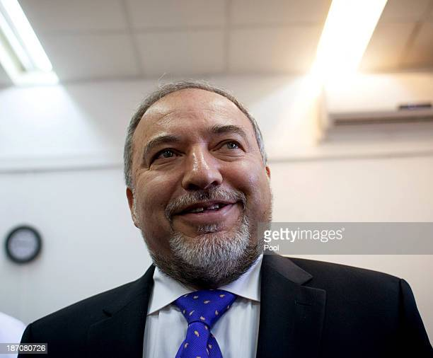 Former Israeli Foreign Minister, Avigdor Lieberman arrives in the courtroom to hear the verdict in his trial in which is he is facing charges of...