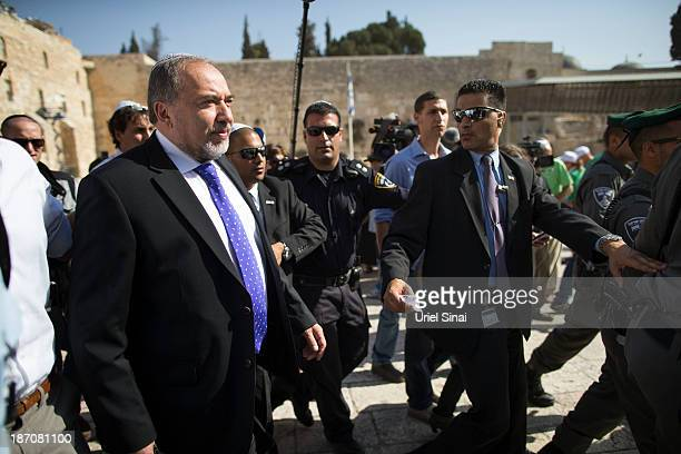 Former Israeli Foreign Minister, Avigdor Lieberman is surrounded by supporters and security as he visits the Western wall after the verdict on...
