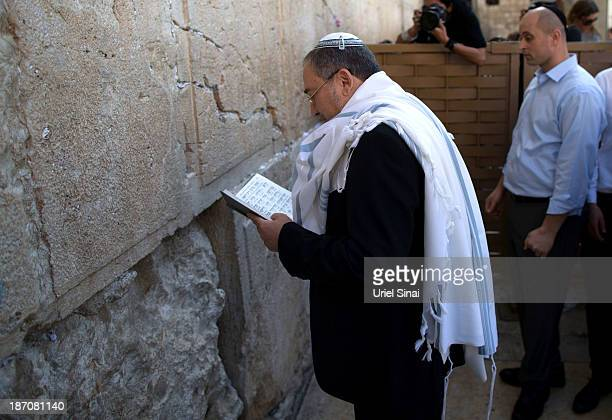 Former Israeli Foreign Minister Avigdor Lieberman prays at the Western wall after the verdict on charges of fraud and breach of trust was given on...