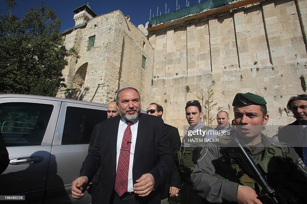 Former Israeli foreign minister Avigdor Lieberman, whose Yisrael Beitenu party is fighting next weeks's general election in alliance with Prime Minister Benjamin Netanyahu's Likud party, is seen near the Tombs of the Patriarchs or Ibrahimi Mosque, a holy site to both Jews and Muslims, in the old quarter of the southern West Bank city of Hebron on January 14, 2013, during his campaign visit to the divided city. Israel goes to the polls on January 22.