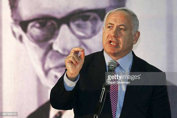 Former Israeli Prime Minister Benjamin Netanyahu makes his speech in front of a poster of the late Prime Minister Menahem Begin during a meeting of...