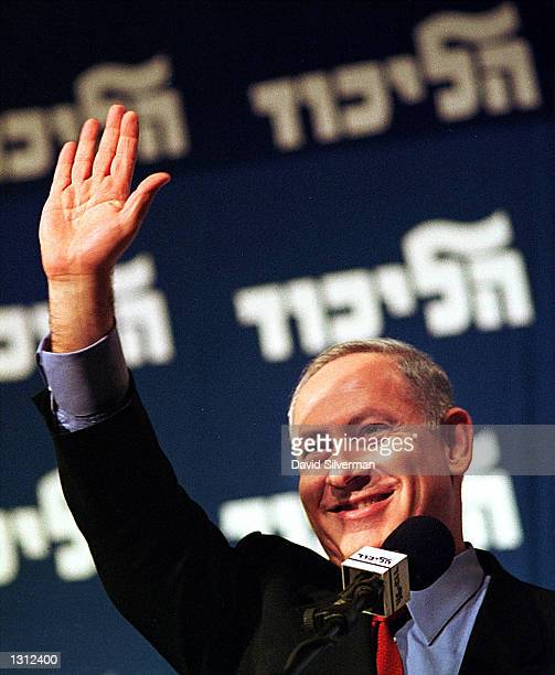 Former Israeli Prime Minister Benjamin Netanyahu waves to a cheering crowd December 12, 2000 as he addresses his right-wing Likud Party''s Central...