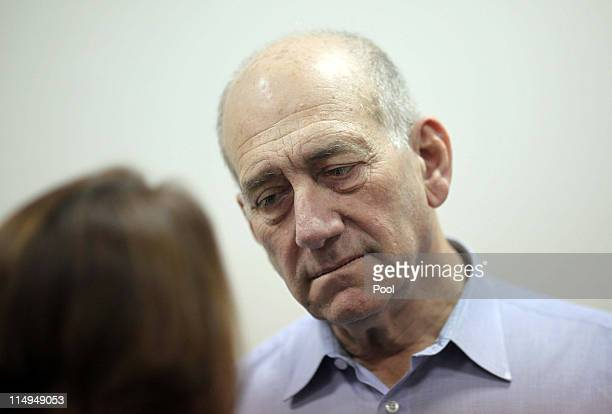 Former Israeli Prime Minister Ehud Olmert arrives for the beginning of his corruption trail at the Jerusalem District Court on May 31, 2011 in...