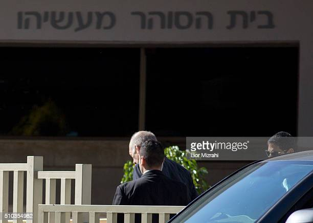 Former Israeli Prime Minister Ehud Olmert , escorted by security personnel, arrives at Maasiyahu Prison on February 15, 2016 in Ramle, Israel....