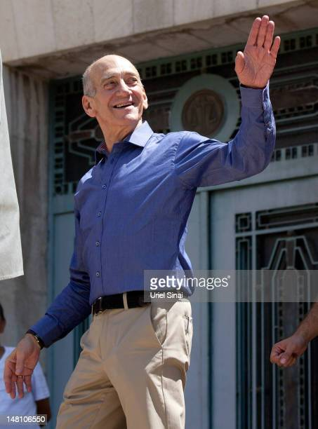 Former Israeli Prime Minister Ehud Olmert leaves the District Court after hearing the verdict in his trial on corruption charges concerned with the...
