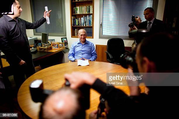 Former Israeli Prime Minister Ehud Olmert poses for photographers after delivering a public statement at his office on April 15, 2010 in Tel Aviv,...