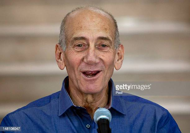 Former Israeli Prime Minister Ehud Olmert speaks to the media at the District Court after hearing the verdict in his trial on corruption charges...